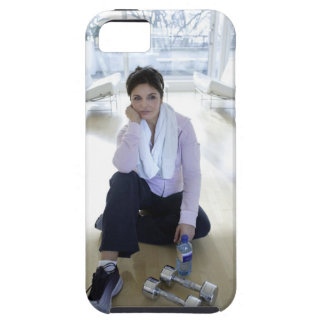 Woman resting on the floor after exercising. iPhone 5 cases