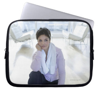 Woman resting on the floor after exercising. laptop sleeve