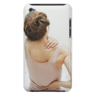 Woman rubbing aching back barely there iPod covers