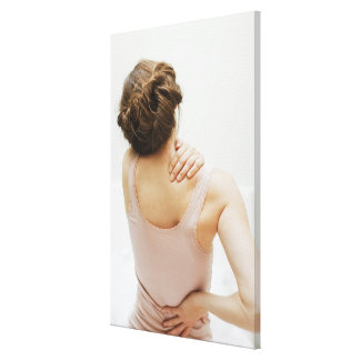 Woman rubbing aching back canvas print