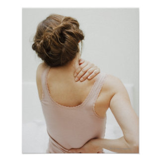 Woman rubbing aching back poster