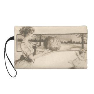 Woman Scaring Cupid Jack O' Lantern Pumpkin Wristlet Clutches
