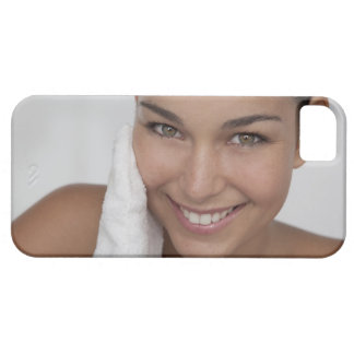 Woman scrubbing her face with cloth case for the iPhone 5