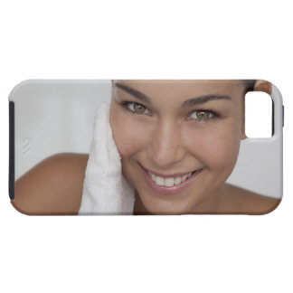 Woman scrubbing her face with cloth iPhone 5 covers