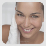 Woman scrubbing her face with cloth sticker