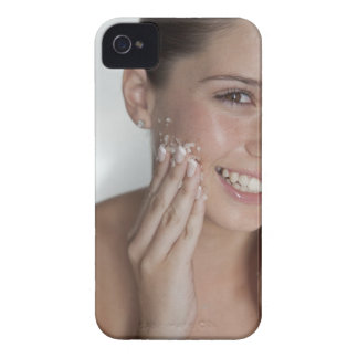 Woman scrubbing sugar on her face iPhone 4 Case-Mate case