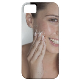 Woman scrubbing sugar on her face iPhone 5 cases