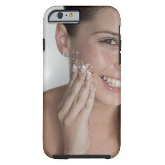 Woman scrubbing sugar on her face tough iPhone 6 case