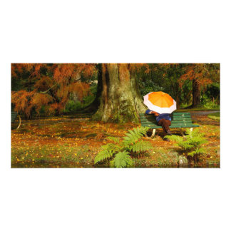 Woman siting with umbrella photo greeting card
