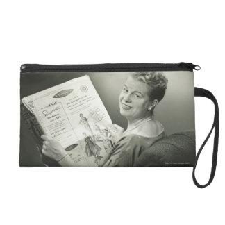 Woman Sitting in Chair Wristlet
