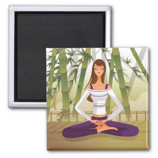 Woman sitting in lotus position, meditating magnet