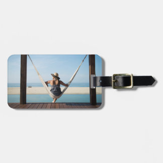 Woman Sitting On A Hammock At A Small Hotel Luggage Tag