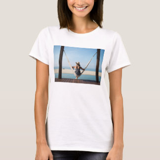 Woman Sitting On A Hammock At A Small Hotel T-Shirt