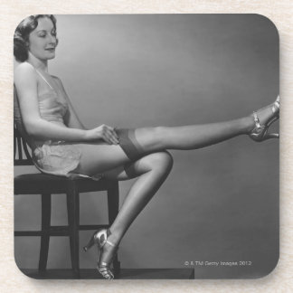 Woman Sitting on Chair Beverage Coaster