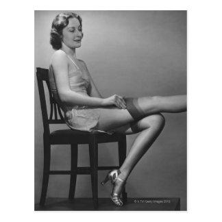 Woman Sitting on Chair Postcard