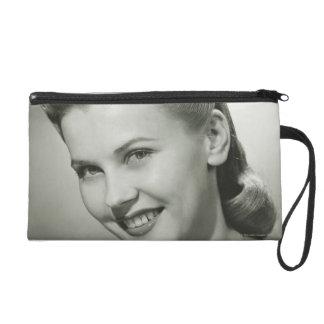 Woman Smiling 2 Wristlet Clutch