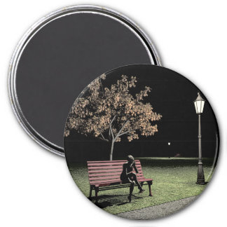 Woman speaking on the telephone in the park 7.5 cm round magnet