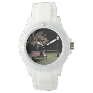 Woman speaking on the telephone in the park wrist watch