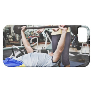 Woman spotting man lifting barbell barely there iPhone 5 case