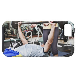 Woman spotting man lifting barbell iPhone 5 case
