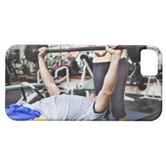 Woman spotting man lifting barbell iPhone 5 cover