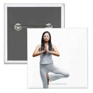 Woman standing in yoga position 15 cm square badge