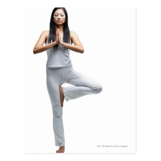 Woman standing in yoga position postcard