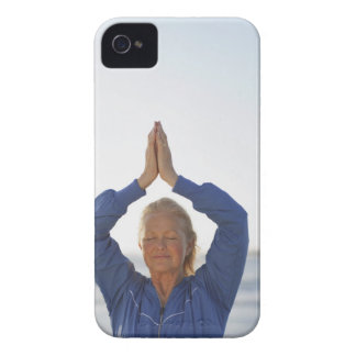 Woman standing with hands clasped overhead iPhone 4 cover