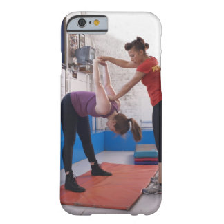 Woman stretching with trainer in gym barely there iPhone 6 case