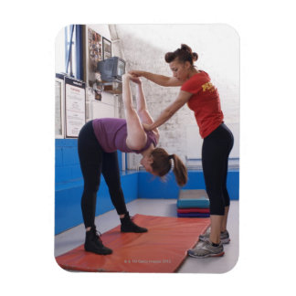 Woman stretching with trainer in gym rectangular photo magnet
