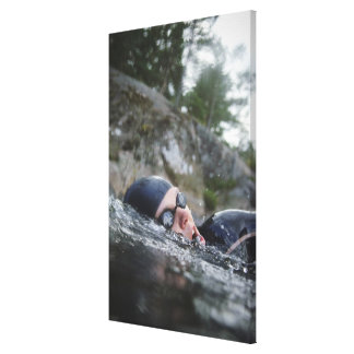 Woman swimming, close-up canvas print