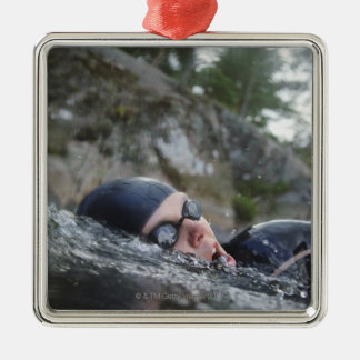 Woman swimming, close-up christmas ornament