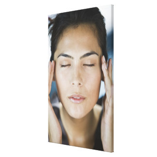 Woman taking a spa treatment stretched canvas print