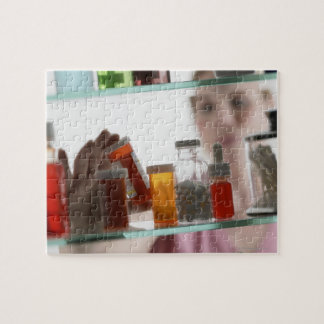 Woman taking pills from medicine cabinet jigsaw puzzle