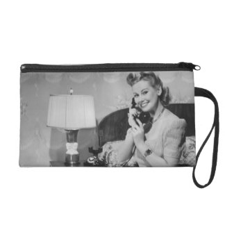 Woman Talking on Phone Wristlet Clutches