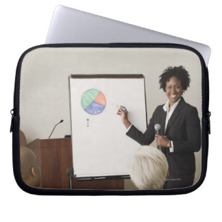 Woman teaching a class to adults laptop computer sleeve
