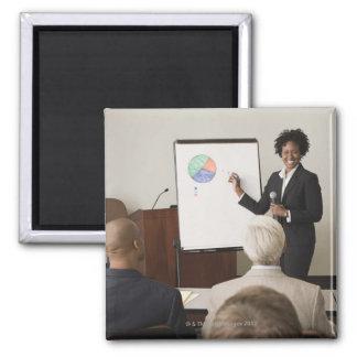 Woman teaching a class to adults fridge magnets