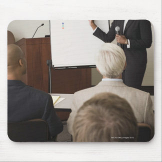Woman teaching a class to adults mouse mat