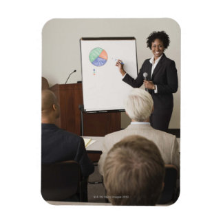 Woman teaching a class to adults rectangular photo magnet