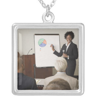 Woman teaching a class to adults silver plated necklace