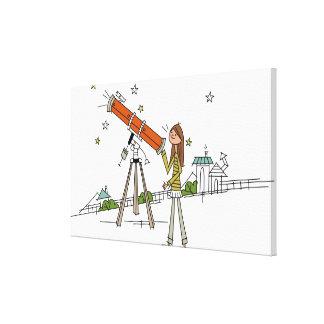 Woman using an astronomy telescope canvas print