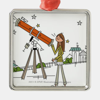 Woman using an astronomy telescope christmas ornament