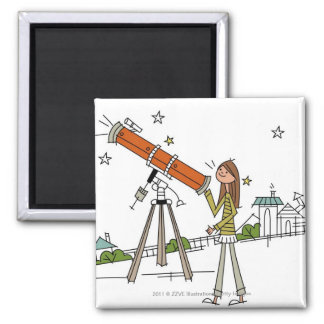 Woman using an astronomy telescope square magnet