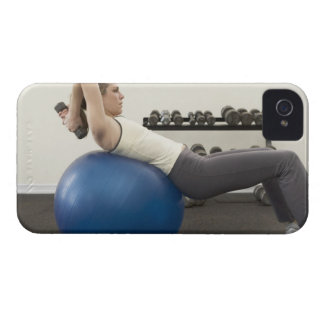 Woman using exercise ball and hand weights iPhone 4 Case-Mate cases