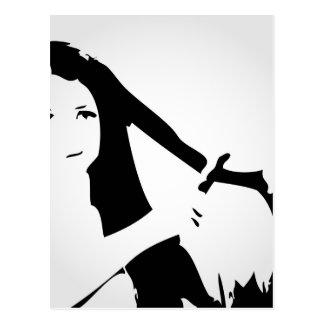 Woman using flat iron on hair postcard