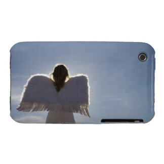 Woman wearing angel wings, rear view, three iPhone 3 covers