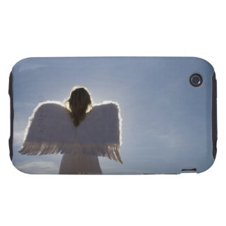 Woman wearing angel wings, rear view, three iPhone 3 tough cases