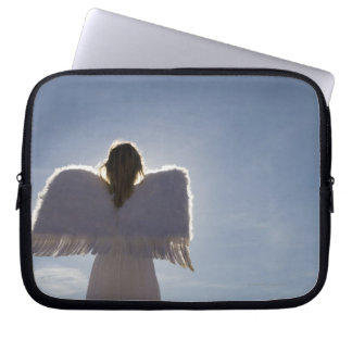 Woman wearing angel wings, rear view, three laptop sleeve