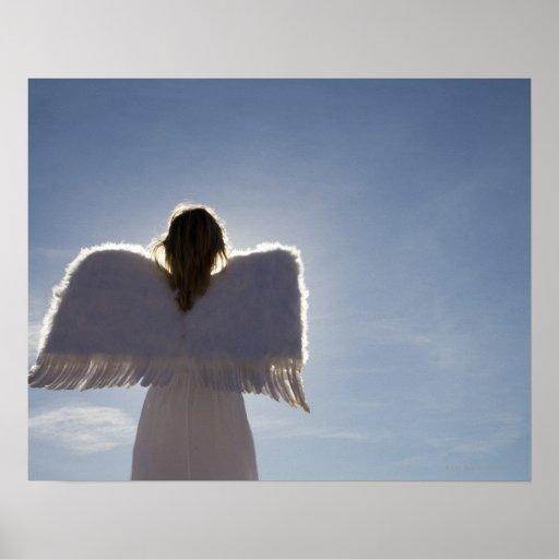 Woman wearing angel wings, rear view, three posters