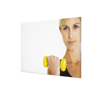 Woman with hand weight canvas print